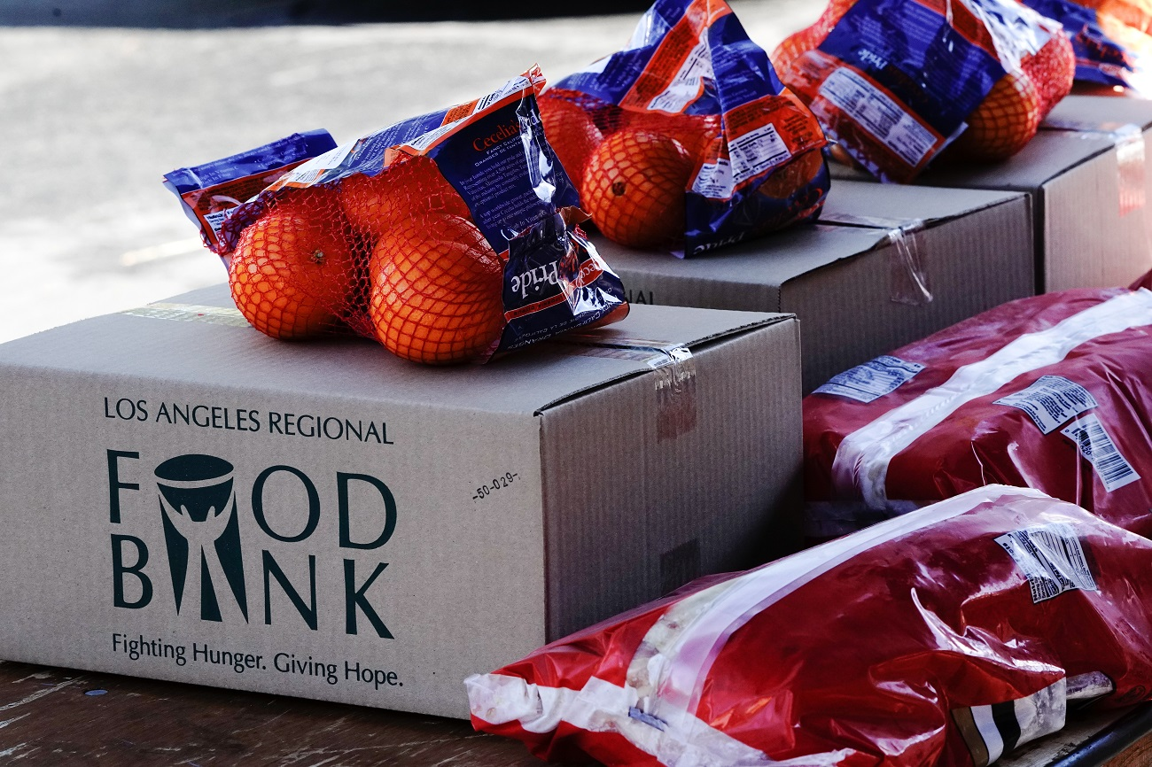 Boxes of food and fruit are seen at a drive-thru food distribution organized by the Los Angeles Regional Food Bank, as the U.S. Senate grapples with whether to increase payments to Americans reeling from the coronavirus disease (COVID-19) pandemic, in West Covina, California, U.S. December 29, 2020.  REUTERS/Bing Guan