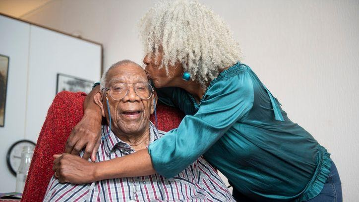 A senior woman gives her 91-year old father a kiss on the head.(LUCY LAMBRIEX ziebinnenzijde.nl / Getty Images)