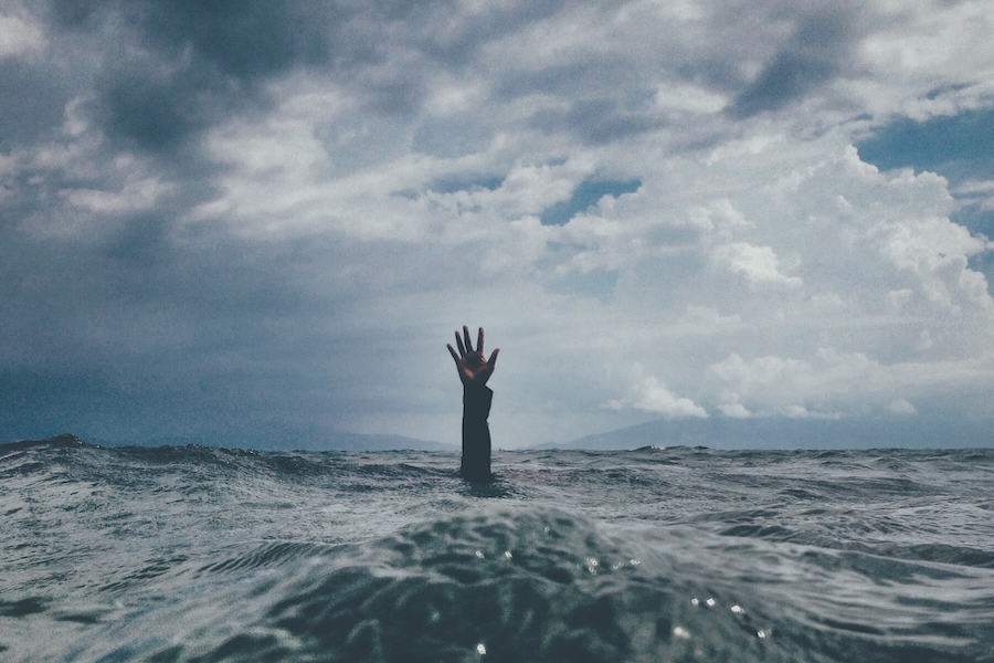 hand coming up through water ocean PTSD in nursing