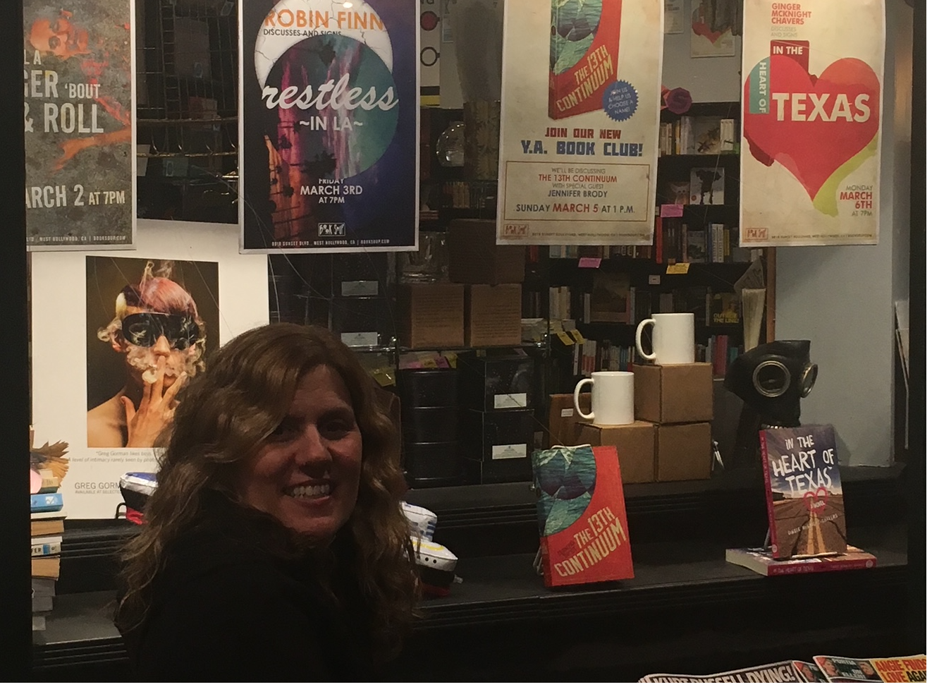 """Pinch me! I am looking at the poster announcing the launch of my novel, """"Restless in L.A."""" (2017) at L.A.s Book Soup."""