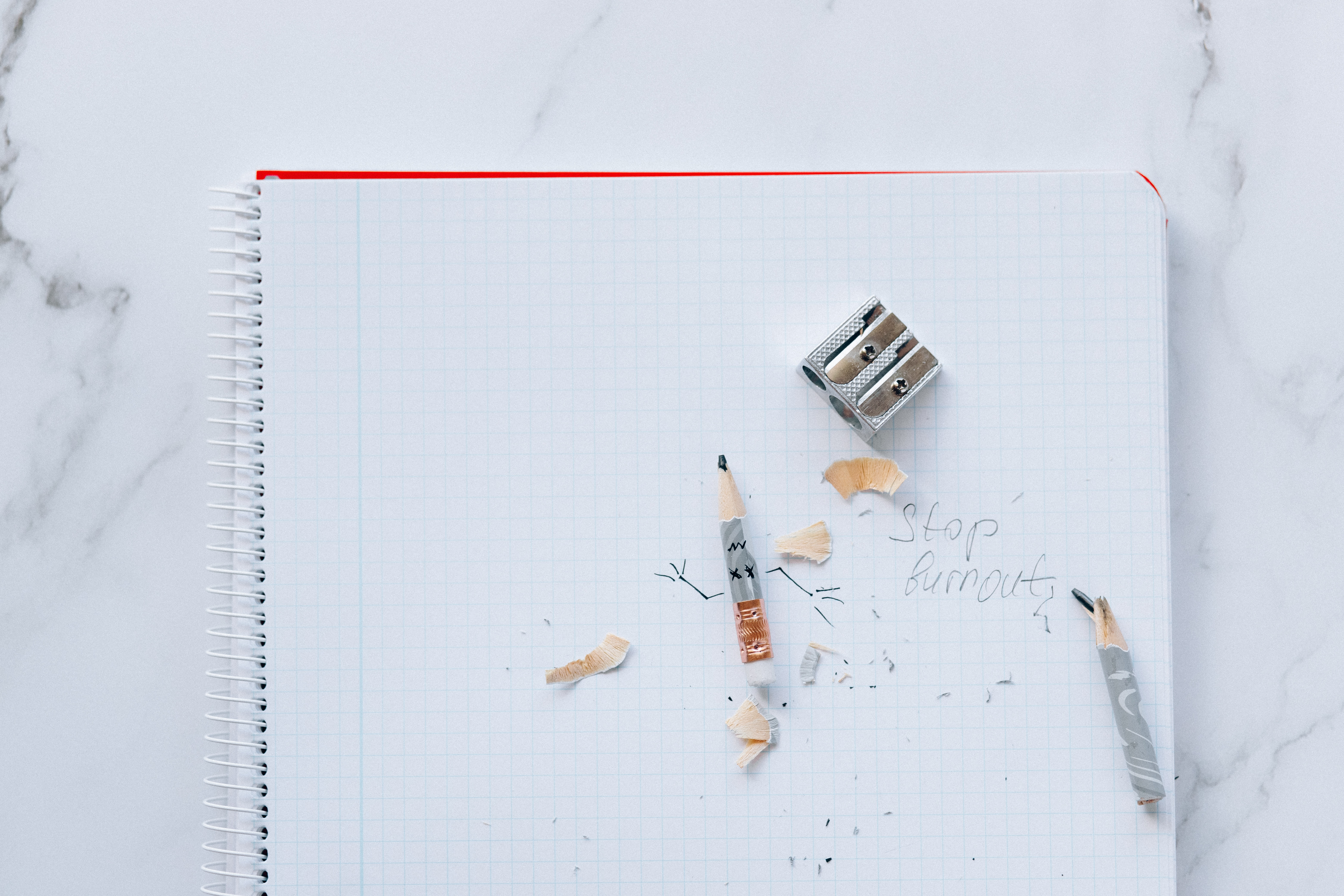 """Pencil and shavings with pencil sharpener on a journal page with the note, """"Stop Burnout"""""""