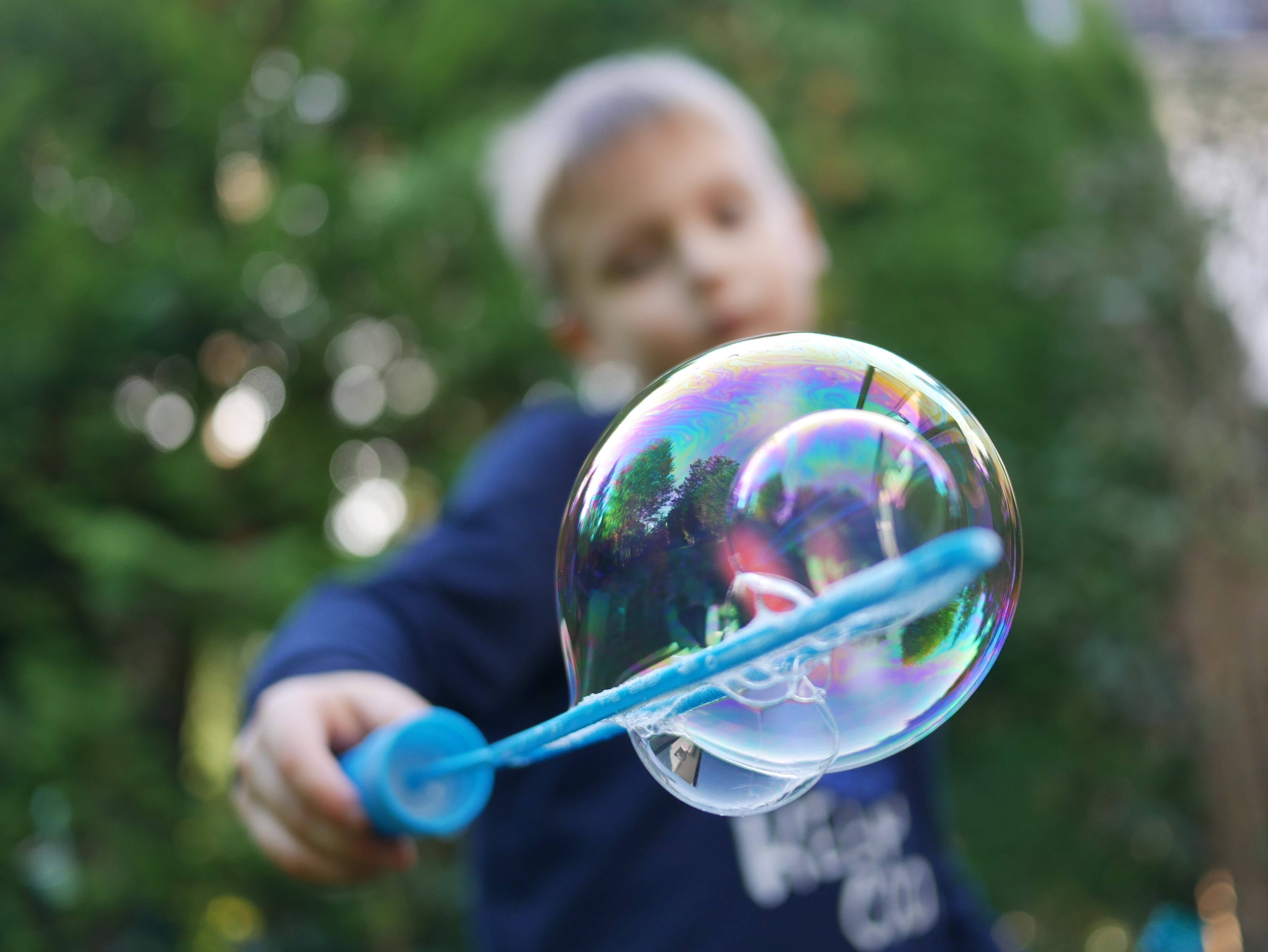 A child blowing soap bubbles helped change my life