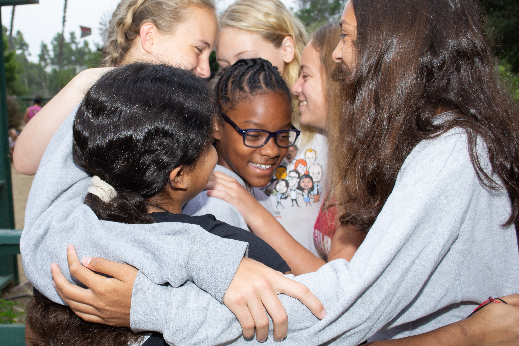 Campers embrace at Experience Camps, before the start of the COVID-19 pandemic.