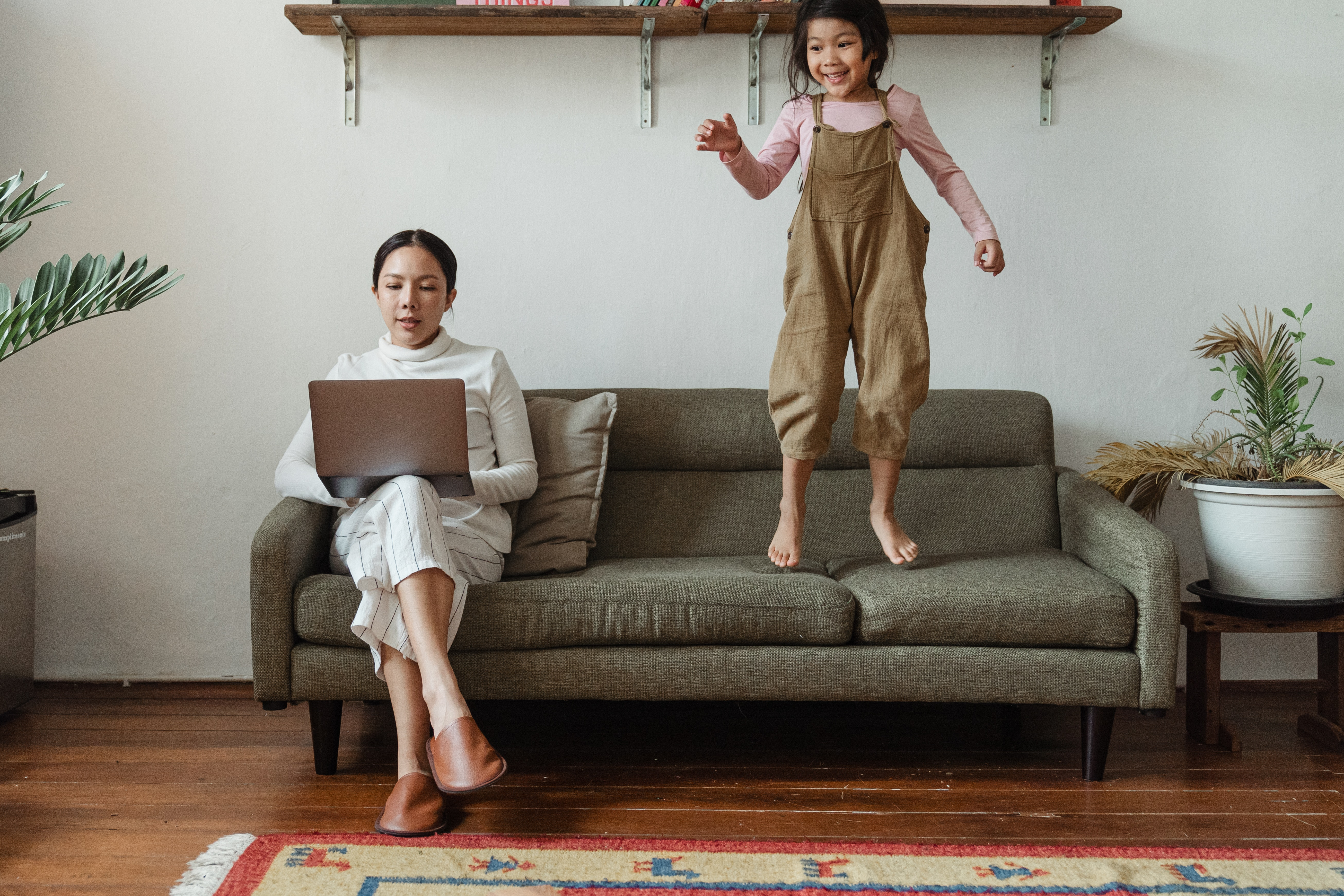 child jumping on furniture