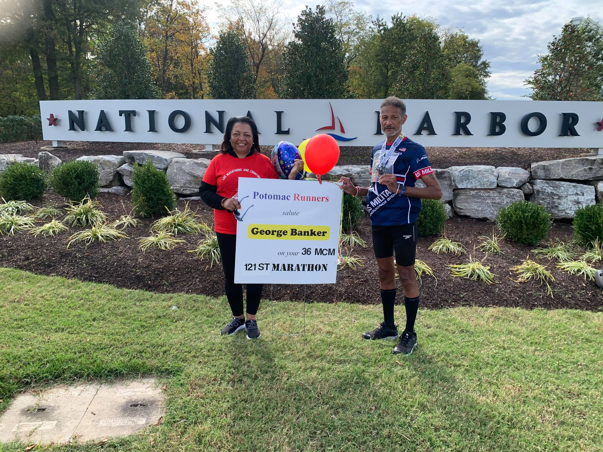 Bernadette and George Banker celebrate his 36th running of the Marine Corps Marathon, his 121st marathon overall and the fourth of his streak during the pandemic. (Photo courtesy of George Banker.)