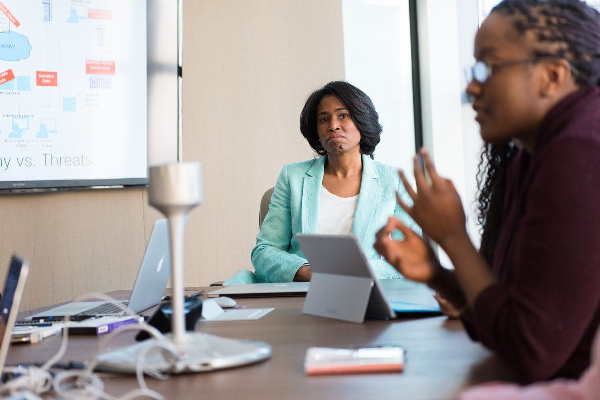 A female boss listening with all attention to her subordinate in the meeting
