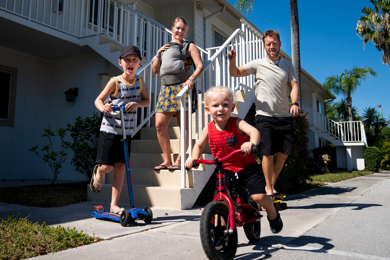 """From left to right Adi Jeremias, 7, Courtney Jeremias, Silas Jeremias, 2 months, Shae Jeremias, 2, and Laszlo Jeremias pose for a portrait at their home in Naples on Tuesday, April 28, 2020. """"Life hasn't been too different for our family because I'm home and I homeschool them anyway. I'm sure that it's been hard for a lot of families, so we're grateful that it hasn't taken such a toll (on us),"""" Courtney said. """"We miss just simple stuff like going to the grocery store all together. At the time we thought 'oh it's crazy having kids in the store,' but now I would just love to go to the store with them."""" Courtney said she's also grateful to have the time at home with Silas, who was born in February. """"It's a nice thing just having to be home with your new baby and adjusting and letting them grow without being exposed to too many people,"""" she said.Ndn 0428 Ad Front Porch Project 003"""