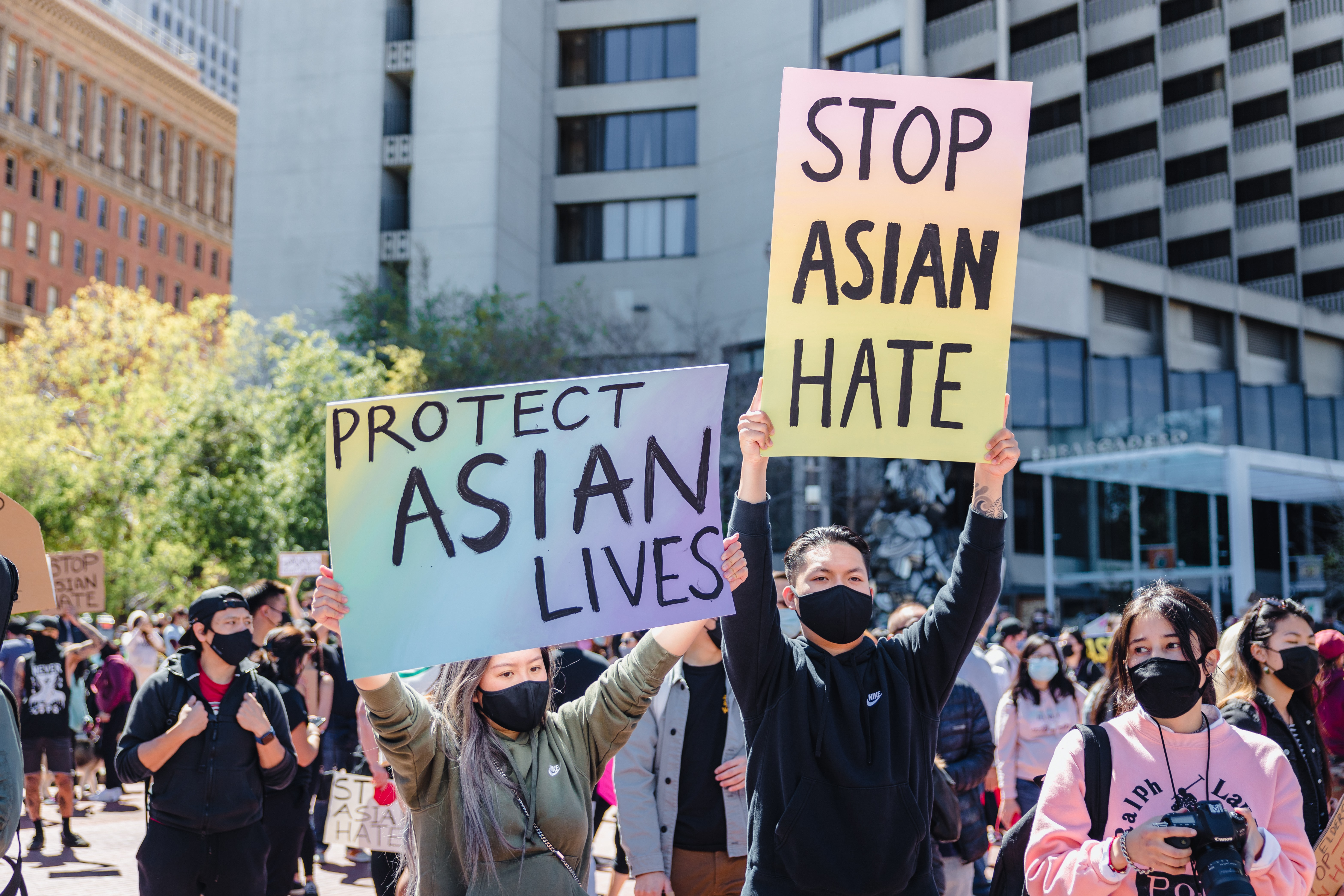 Stop Asian Hate and Protect Asian Lives Signs at a rally