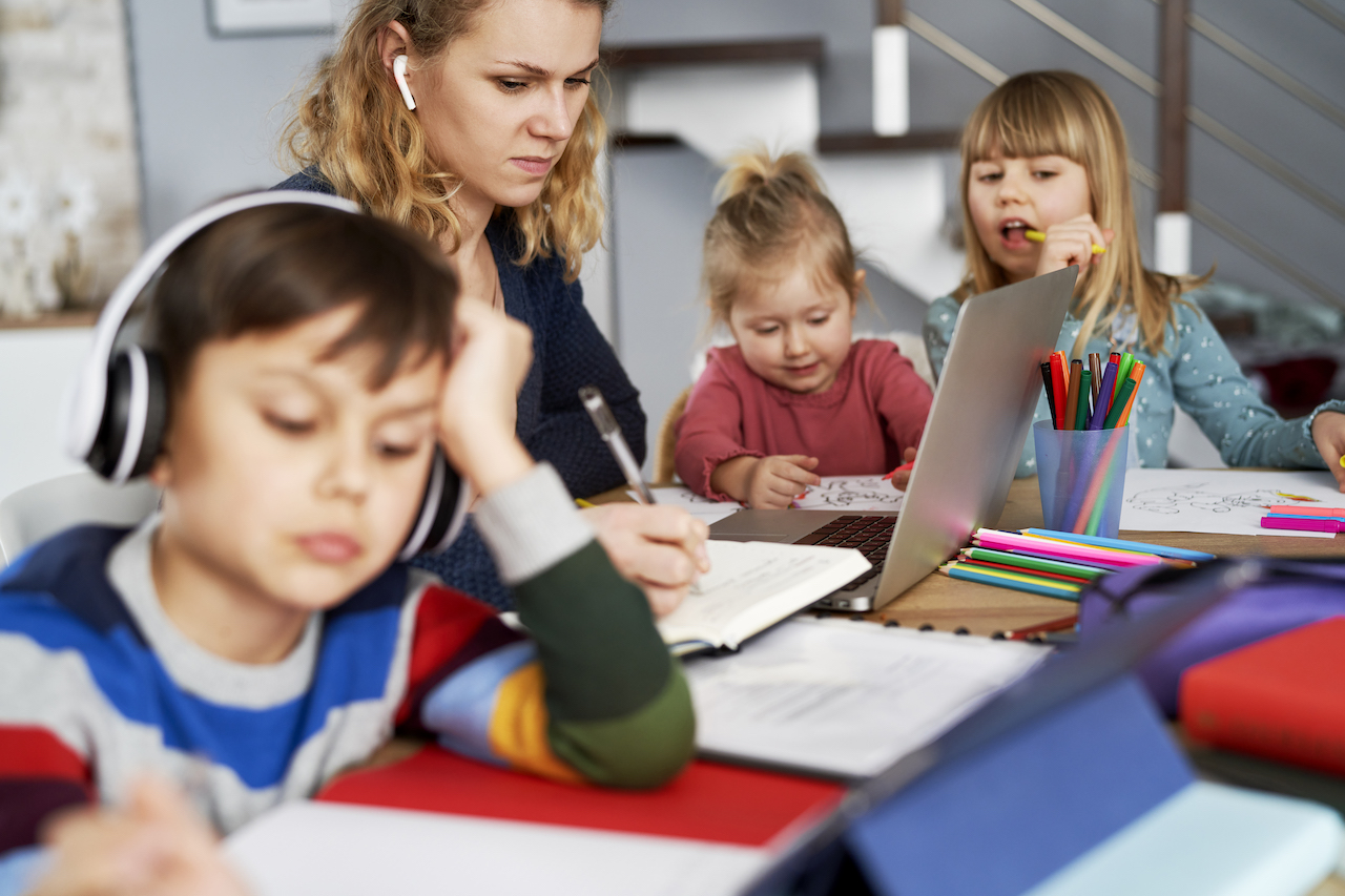 Frustrated mother during home office with children at home