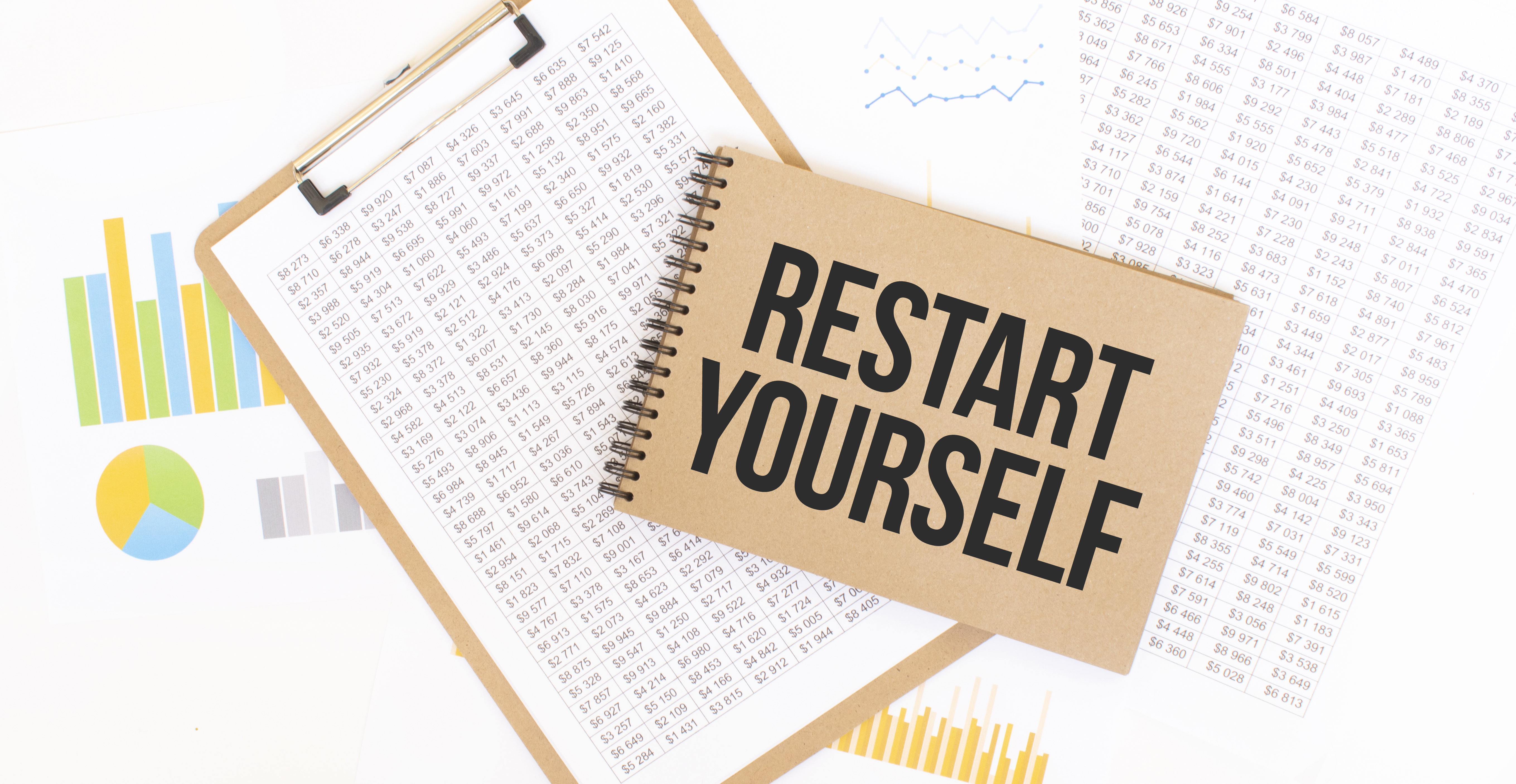 Text Restart Yourself on brown paper notepad on the table with diagram. Business concept