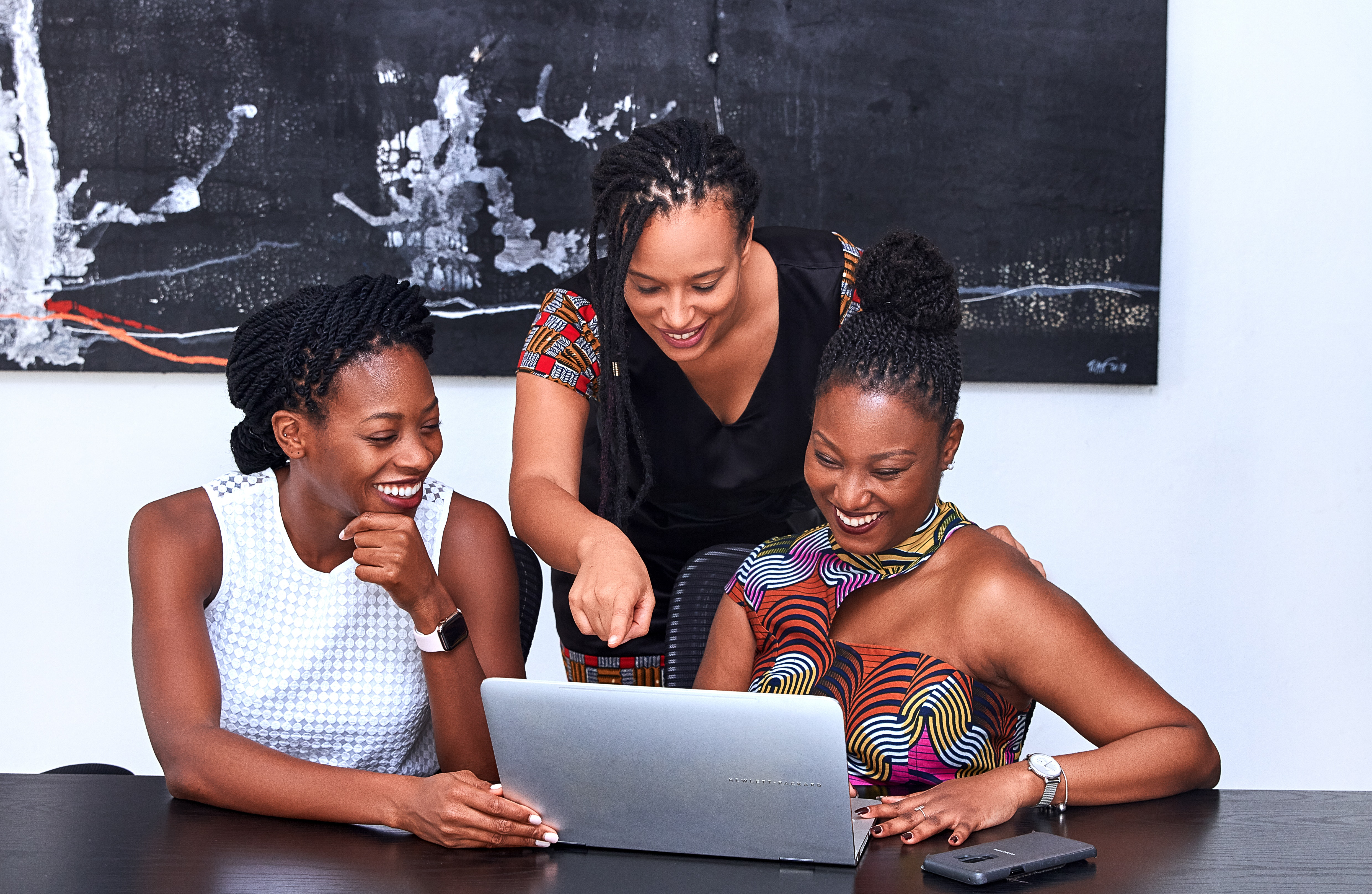 Three Women Looking At The Computer