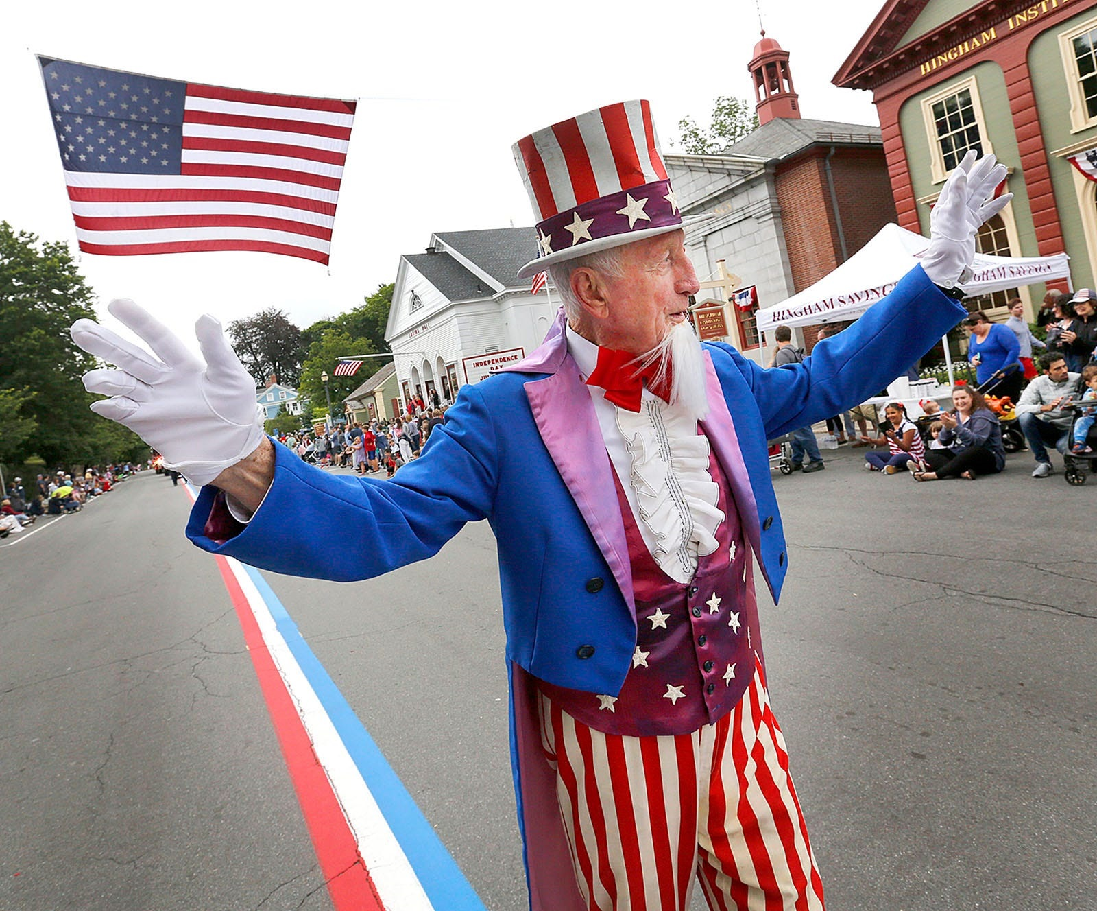 LEAD IMAGEUncle Sam- George Ford-82 leads the parade.The annual July 4th parade in Hingham Square on Sunday July 4, 2021 Greg Derr/The Patriot Ledger070421 Gd Hin Parade13 Jpg