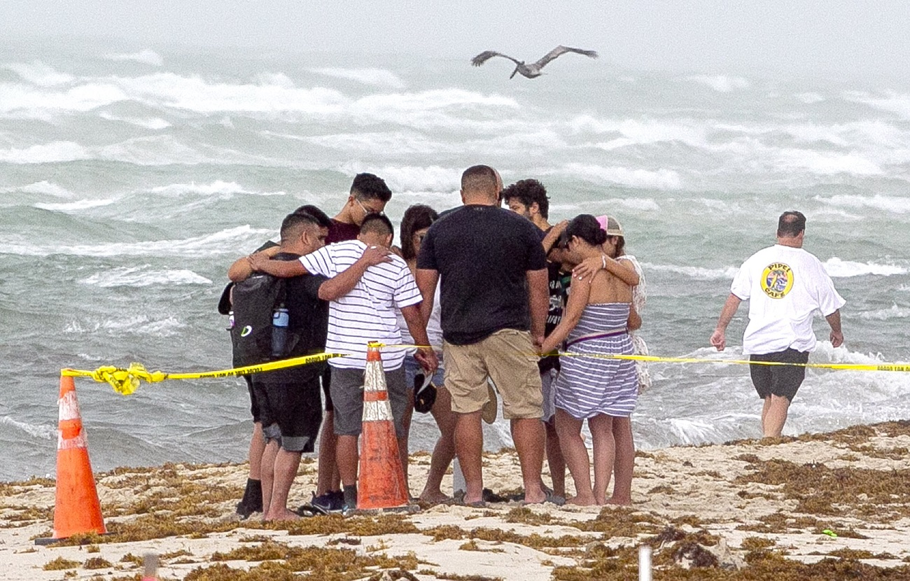 NO FILM, NO VIDEO, NO TV, NO DOCUMENTARY - A group of people pray together on the beach next to the site of the Champlain Towers South Condo in Surfside on Friday, June 25, 2021. Photo by Pedro Portal/Miami Herald/TNS/ABACAPRESS.COM