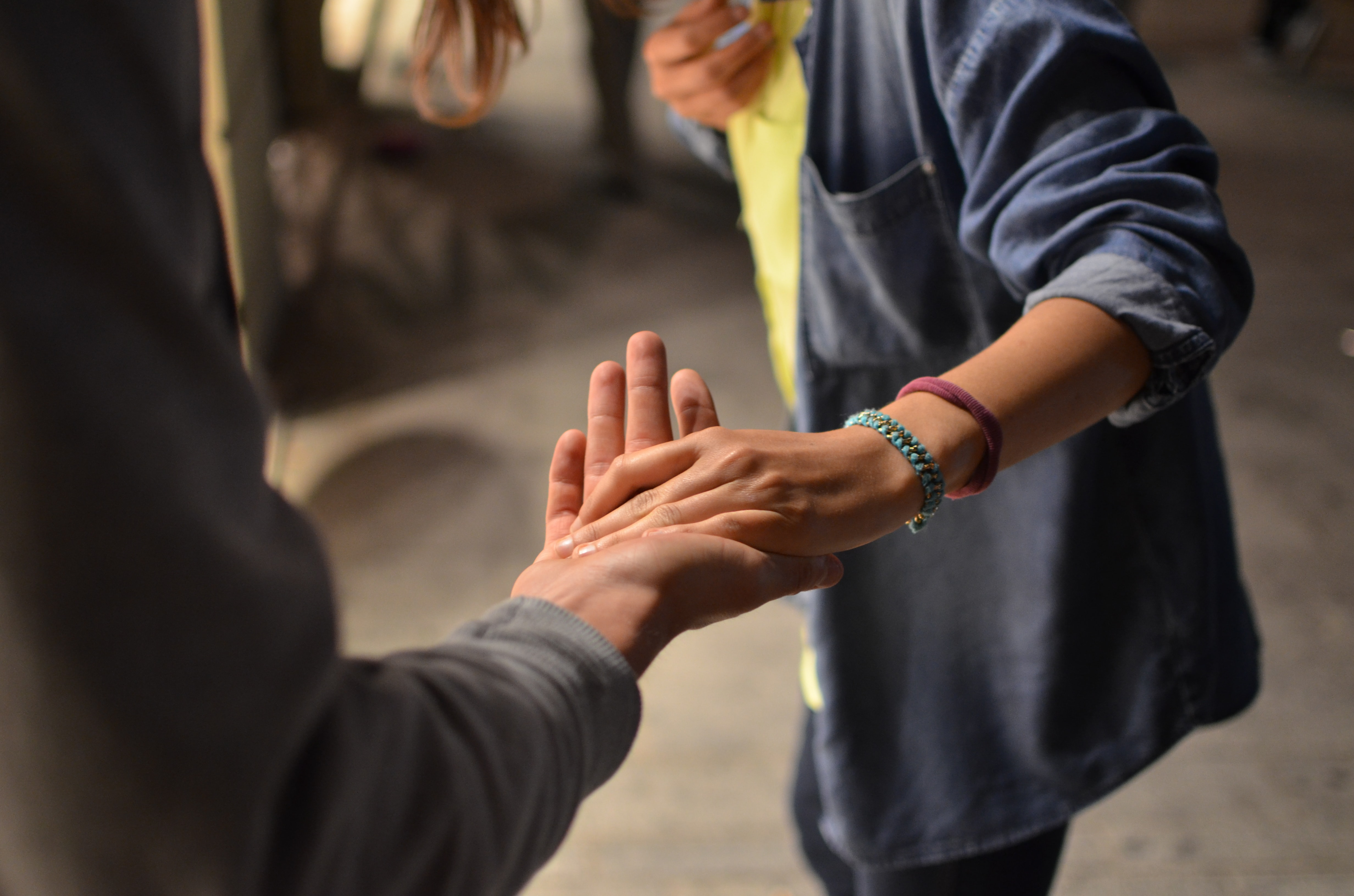 an image of people holding hands discussing the importance of mental health