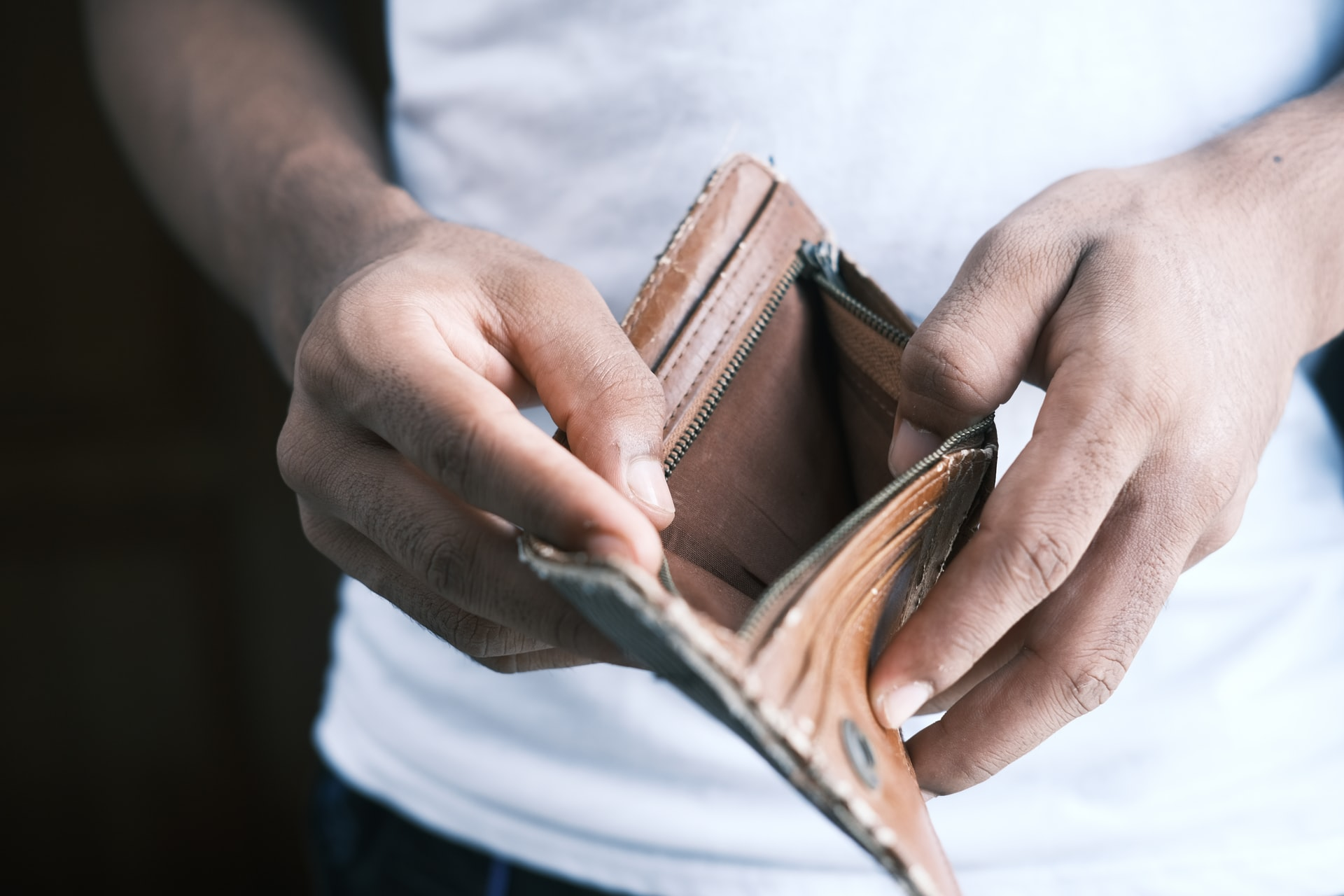 person holding wallet