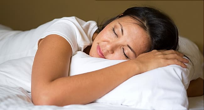 woman sleeping restfully on pillow